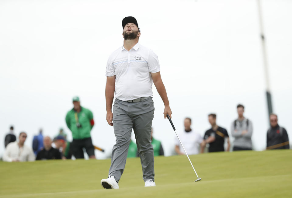 Spain's Jon Rahm reacts after missing a putt on the 17th green during the first round British Open Golf Championship at Royal St George's golf course Sandwich, England, Thursday, July 15, 2021. (AP Photo/Peter Morrison)