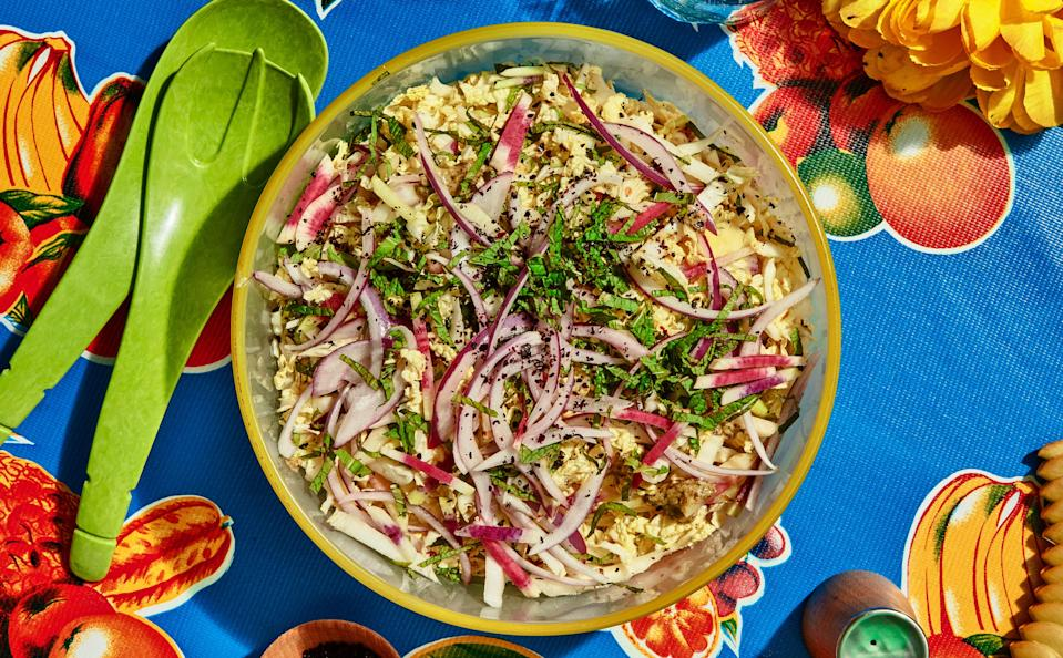 "Charred scallions provide toasty depth while lime zest and juice bring brightness to this spicy dressing from <a href=""https://www.lildebsoasis.com/"" rel=""nofollow noopener"" target=""_blank"" data-ylk=""slk:Lil' Deb's Oasis"" class=""link rapid-noclick-resp"">Lil' Deb's Oasis</a> in Hudson, New York. <a href=""https://www.bonappetit.com/recipe/cabbage-slaw-with-charred-scallions-and-lime-dressing?mbid=synd_yahoo_rss"" rel=""nofollow noopener"" target=""_blank"" data-ylk=""slk:See recipe."" class=""link rapid-noclick-resp"">See recipe.</a>"