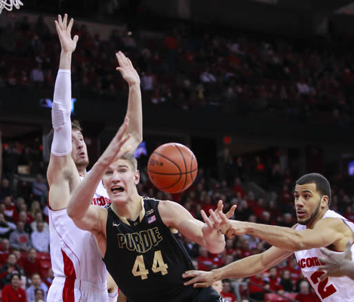 Wisconsin's Traevon Jackson, right, knocks the ball loose from Purdue's Isaac Haas, center, as Wisconsin's Frank Kaminsky defends during the first half of an NCAA college basketball game Wednesday, Jan. 7, 2015, in Madison, Wis. (AP Photo/Andy Manis)