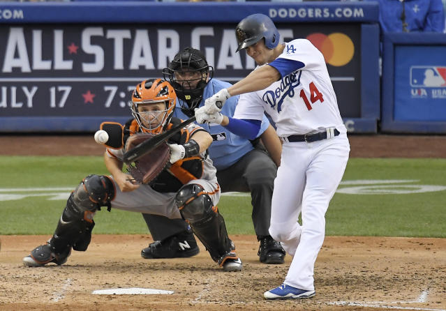 Los Angeles Dodgers' Enrique Hernandez, right, hits a two-run home run as San Francisco Giants catcher Buster Posey, left, watches along with home plate umpire Dan Bellino during the fifth inning of a baseball game Saturday, June 16, 2018, in Los Angeles. (AP Photo/Mark J. Terrill)