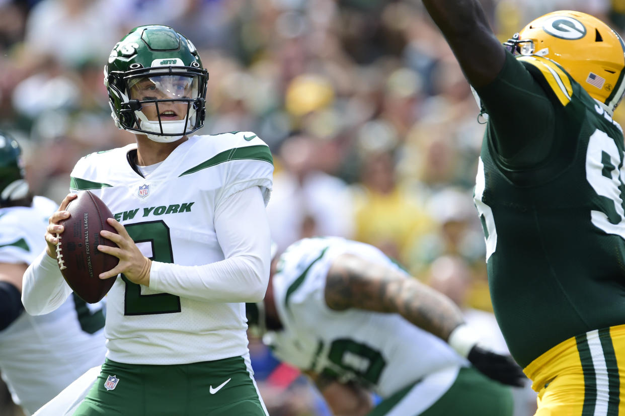 GREEN BAY, WISCONSIN - AUGUST 21: Zach Wilson #2 of the New York Jets looks to throw a pass against the Green Bay Packers in the first half of a preseason game at Lambeau Field on August 21, 2021 in Green Bay, Wisconsin. (Photo by Patrick McDermott/Getty Images)