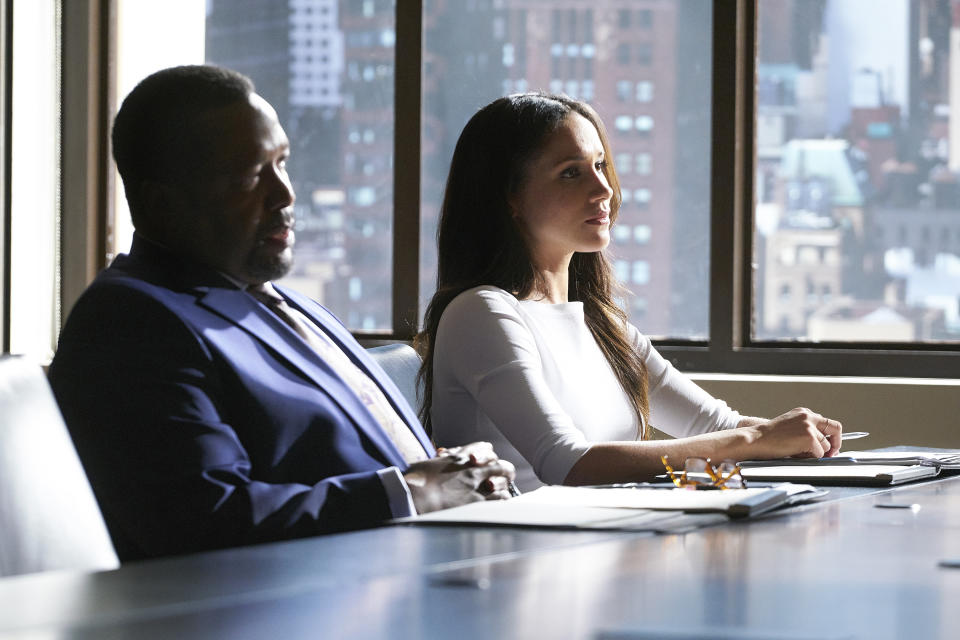 "SUITS -- ""Shame"" Episode 709 -- Pictured: (l-r) Wendell Pierce as Robert Zane, Meghan Markle as Rachel Zane -- (Photo by: Ian Watson/USA Network/NBCU Photo Bank/NBCUniversal via Getty Images)"