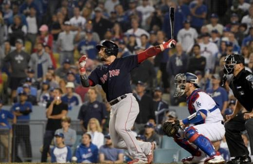 Red Sox first baseman Steve Pearce follows through on his bases-clearing double in World Series Game 4. (Getty Images)