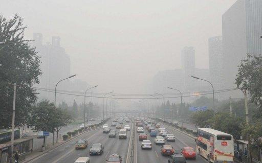 Traffic makes its way through thick haze in Beijing in October 2011. Beijing's government on Friday bowed to a vocal online campaign for a change in the way air quality is measured in the Chinese capital, one of the world's most polluted cities