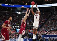 <p>Malik Dunbar #4 of the Auburn Tigers shoots the ball during the second half against the New Mexico State Aggies in the first round of the 2019 NCAA Men's Basketball Tournament at Vivint Smart Home Arena on March 21, 2019 in Salt Lake City, Utah. (Photo by Tom Pennington/Getty Images) </p>