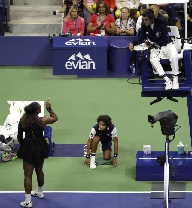 FILE - In this Sept. 8, 2018, file photo, Serena Williams, left, talks with chair umpire Carlos Ramos during the women's final of the U.S. Open tennis tournament against Naomi Osaka, of Japan, in New York. The indelible image from last year's U.S. Open does not involve anyone holding a trophy or making a particularly remarkable shot. It will be Williams pointing a finger at Ramos as she insisted he owed her an apology. (AP Photo/Seth Wenig, File)