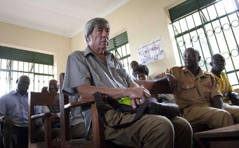 Briton Bernard Randall, 65, who is being charged with trafficking in obscene publications, attends a trial hearing which was postponed until December, in Entebbe, Uganda Monday, Nov. 18, 2013. Randall, who told journalists that he was innocent but worried about the court proceedings in Uganda where homosexuality is illegal under Ugandan laws and gay leaders say their community is often persecuted, was arrested after images of him having gay sex were published following the theft of his laptop computer and faces up to two years in prison if convicted. (AP Photo/Rebecca Vassie)