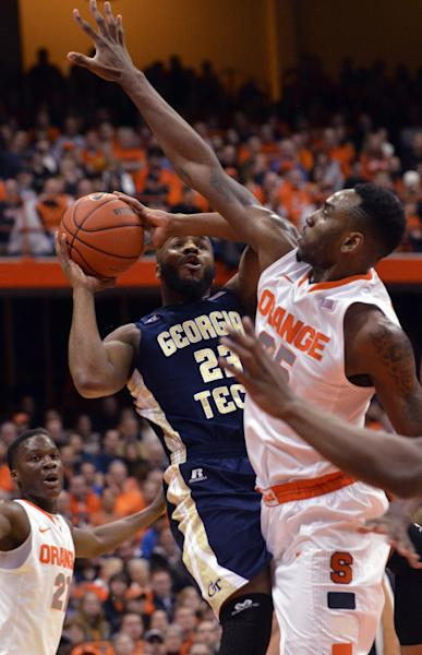 Georgia Tech's Trae Golden drives against Syracuse's Rakeem Christmas during the first half of an NCAA college basketball game in Syracuse, N.Y., Tuesday, March 4, 2014. (AP Photo/Kevin Rivoli)