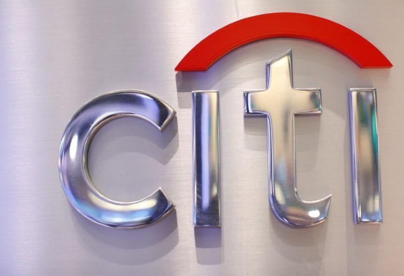 FILE PHOTO: A Citi sign is seen at the Citigroup stall on the floor of the New York Stock Exchange