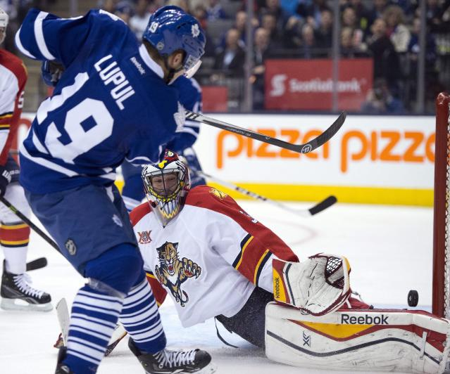 Toronto Maple Leafs left winger Joffrey Lupul is stopped by Florida Panthers goaltender Scott Clemmensen during the second period of an NHL hockey game in Toronto on Thursday, Jan. 30, 2014. (AP Photo/The Canadian Press, Frank Gunn)