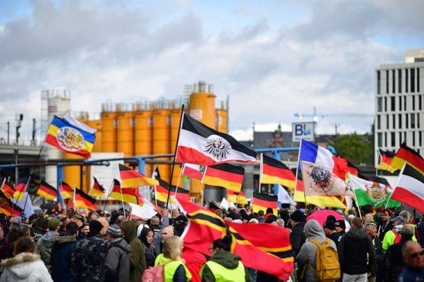 PHOTO: Far-right protestors hold Reichskriegsflaggen, the German Nationa Flag and Wirmer Flags at Berlin Central Station on German Unity Day on Oct. 3, 2019 in Berlin. (Alexander Koerner/Getty Images, FILE)