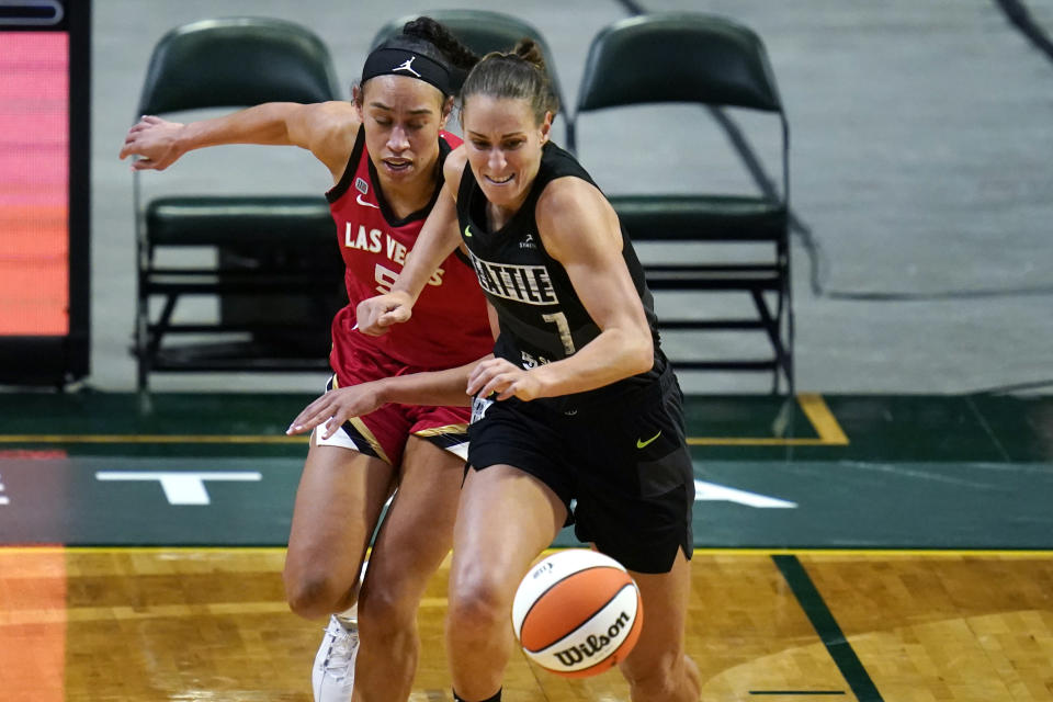 Seattle Storm's Stephanie Talbot (7) beats Las Vegas Aces' Dearica Hamby to a loose ball in the first half of a WNBA basketball game Saturday, May 15, 2021, in Everett, Wash. (AP Photo/Elaine Thompson)