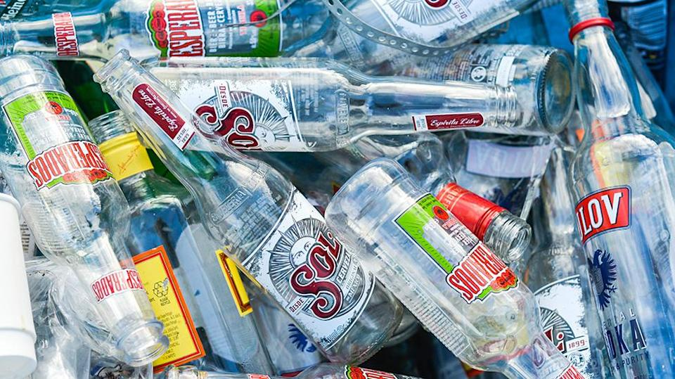 Your empty beer and wine bottles can be recycled. Source: Getty