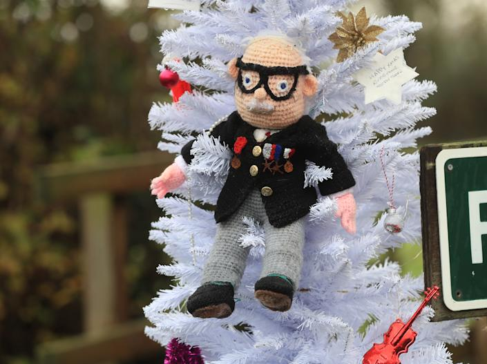 A hand knitted Christmas bauble of Captain Sir Tom Moore hangs on the village Christmas tree in the centre of Allington, Lincolnshire. (Photo by Mike Egerton/PA Images via Getty Images)