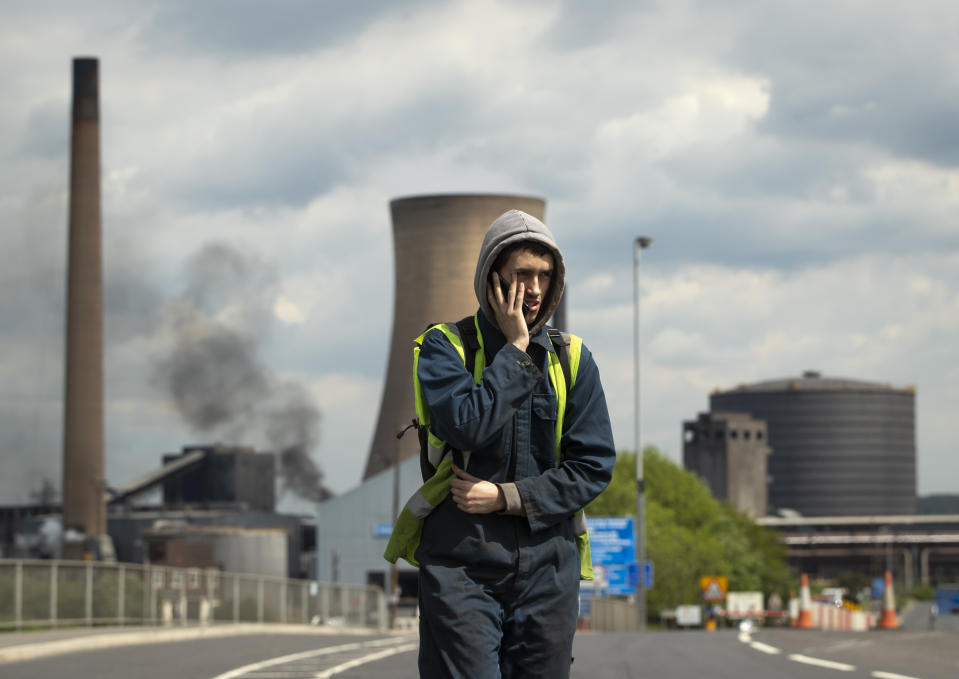 Workers leave the steelworks plant in Scunthorpe following a shift change as owner British Steel is to go into official recievership after failing to secure funds for its future.
