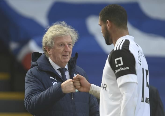 Crystal Palace manager Roy Hodgson with Fulham's Ruben Loftus-Cheek after the English Premier League soccer match between Crystal Palace and Fulham at Selhurst Park stadium in London, England Sunday, Feb.28, 2021. (Mike Hewitt/Pool via AP)