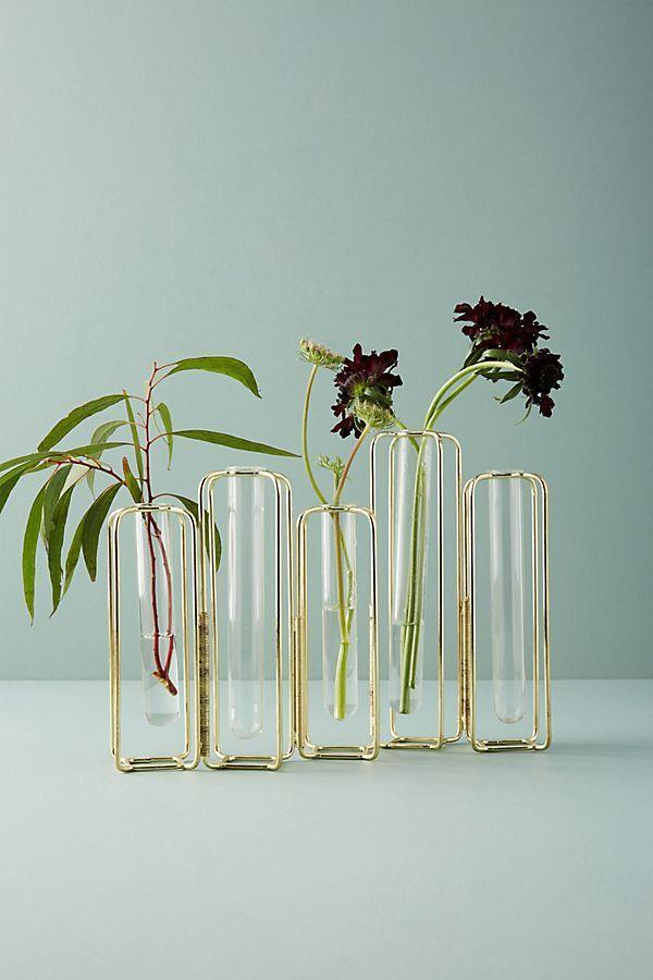 """<p><strong>Anthropologie</strong></p><p>anthropologie.com</p><p><strong>$28.00</strong></p><p><a href=""""https://go.redirectingat.com?id=74968X1596630&url=https%3A%2F%2Fwww.anthropologie.com%2Fshop%2Fstaggered-vase&sref=https%3A%2F%2Fwww.housebeautiful.com%2Fentertaining%2Fholidays-celebrations%2Fg11%2Fthanksgiving-table-setting-ideas-1011%2F"""" rel=""""nofollow noopener"""" target=""""_blank"""" data-ylk=""""slk:BUY NOW"""" class=""""link rapid-noclick-resp"""">BUY NOW</a></p><p>These vases are all connected and can be placed in a line for a longer table or in a circle, if you wish.</p>"""