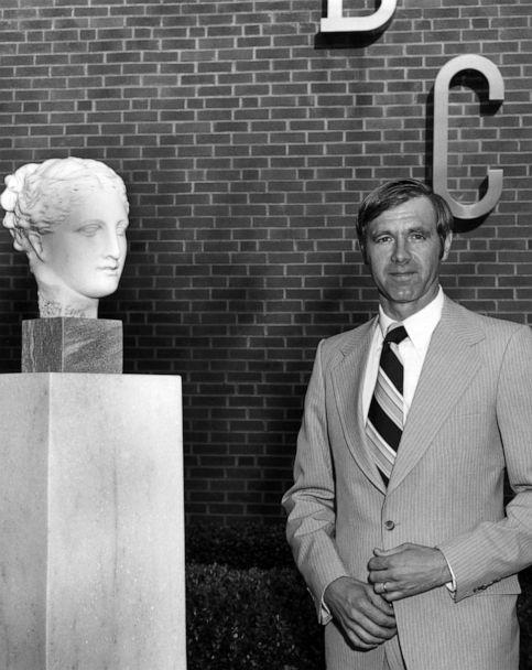 PHOTO: Former Centers for Disease Control director William H Foege stands next to a bust of Hygeia, the Greek goddess of health, 1985. (Smith Collection via Getty Images)