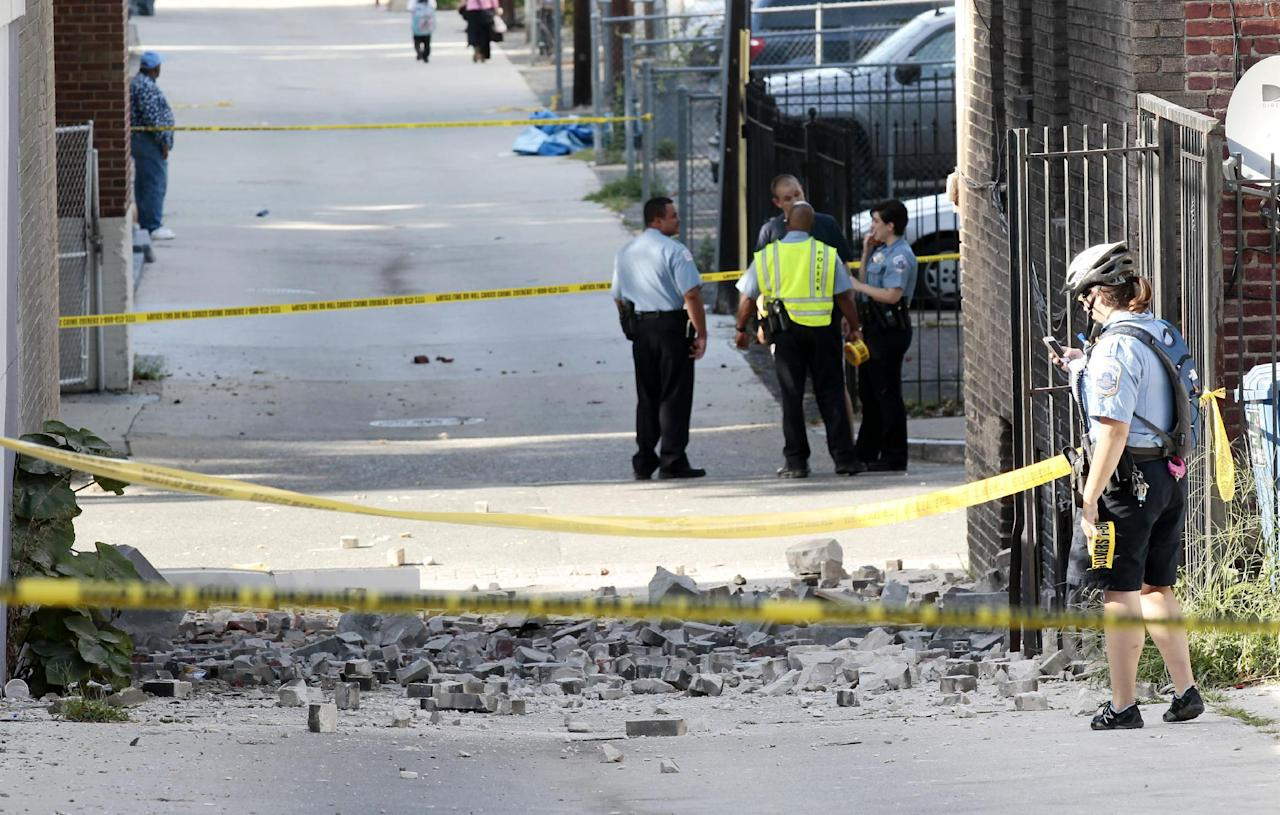 Police block off the alley behind the Embassy of Ecquador in Washington after part of the building sustained damages, Tuesday, Aug. 23, 2011, after a earthquake in the Washington area. (AP Photo/Pablo Martinez Monsivais)
