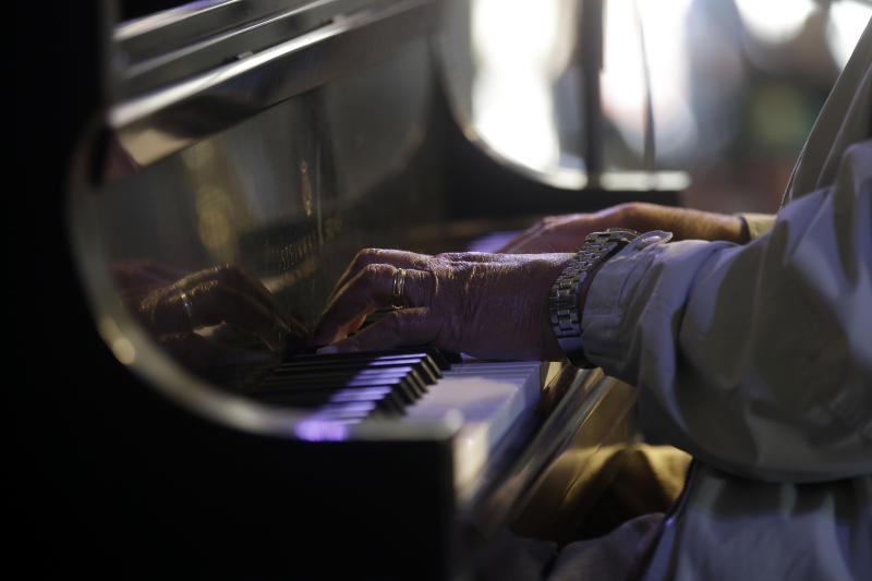 Jazz Pianist Ellis Marsalis, father of musicians Wynton Marsalis, Branford Marsalis, Delfeao Marsalis and Jason Marsalis, performs at the New Orleans Jazz and Heritage Festival in New Orleans, Sunday, May 5, 2013. (AP Photo/Gerald Herbert)