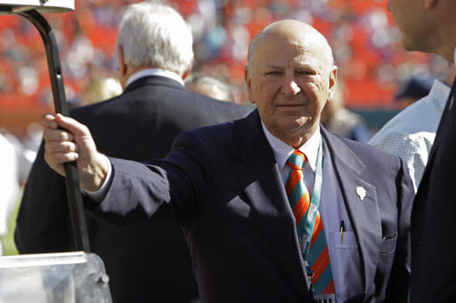 Former Miami Dolphins owner, H. Wayne Huizenga stands on the field before an NFL football between the Miami Dolphins and New York Jets, game Sunday, Jan. 1, 2012, in Miami. (AP Photo/Lynne Sladky)