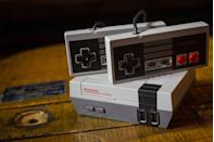"""<p>Every <a href=""""https://www.amazon.com/Nintendo-Entertainment-System-NES-Classic/dp/B01IFJBQ1E/ref=sr_1_4?tag=syn-yahoo-20&ascsubtag=%5Bartid%7C2139.g.34237656%5Bsrc%7Cyahoo-us"""" rel=""""nofollow noopener"""" target=""""_blank"""" data-ylk=""""slk:retro gamer"""" class=""""link rapid-noclick-resp"""">retro gamer</a> had their own technique for getting old cartridges to work when they were on the fritz (remember blowing into the console?). Technical issues like these are resolved forever, thanks to direct downloads.</p>"""