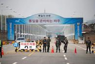 South Korean soldiers stand guard at a checkpoint on the Grand Unification Bridge that leads to the Peace House, the venue for the Inter-Korean summit, near the demilitarized zone separating the two Koreas, in Paju, South Korea, April 26, 2018. REUTERS/Kim Hong-Ji
