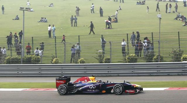 Red Bull Formula One driver Sebastian Vettel of Germany drives during the qualifying session of the Indian F1 Grand Prix at the Buddh International Circuit in Greater Noida, on the outskirts of New Delhi, October 26, 2013. REUTERS/Adnan Abidi (INDIA - Tags: SPORT MOTORSPORT F1)