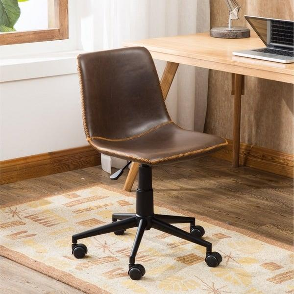 """<h2>Overstock Cesena Faux Leather 360 Swivel Air Lift Office Chair</h2><br>This chair's steel frame offers sturdy support and the faux leather upholstery adds a nice sophisticated touch to your office space. <br><br><strong>The Hype</strong>: 45. out of 5 stars and 360 reviews <br><br><strong>WFH Pros Say</strong>: """"Such a great-looking chair. Perfect for one of our home offices. The surface is faux leather but looks very nice. Easy to assemble and comfortable, adjustable seating.""""<br><br><em>Shop</em> <strong><em><a href=""""http://overstock.com"""" rel=""""nofollow noopener"""" target=""""_blank"""" data-ylk=""""slk:Overstock"""" class=""""link rapid-noclick-resp"""">Overstock</a></em></strong><br><br><strong>Overstock</strong> Cesena Faux Leather 360 Swivel Air Lift Office Chair, $, available at <a href=""""https://go.skimresources.com/?id=30283X879131&url=https%3A%2F%2Fwww.overstock.com%2FHome-Garden%2FCesena-Faux-Leather-360-Swivel-Air-Lift-Office-Chair%2F18024446%2Fproduct.html"""" rel=""""nofollow noopener"""" target=""""_blank"""" data-ylk=""""slk:Overstock"""" class=""""link rapid-noclick-resp"""">Overstock</a>"""