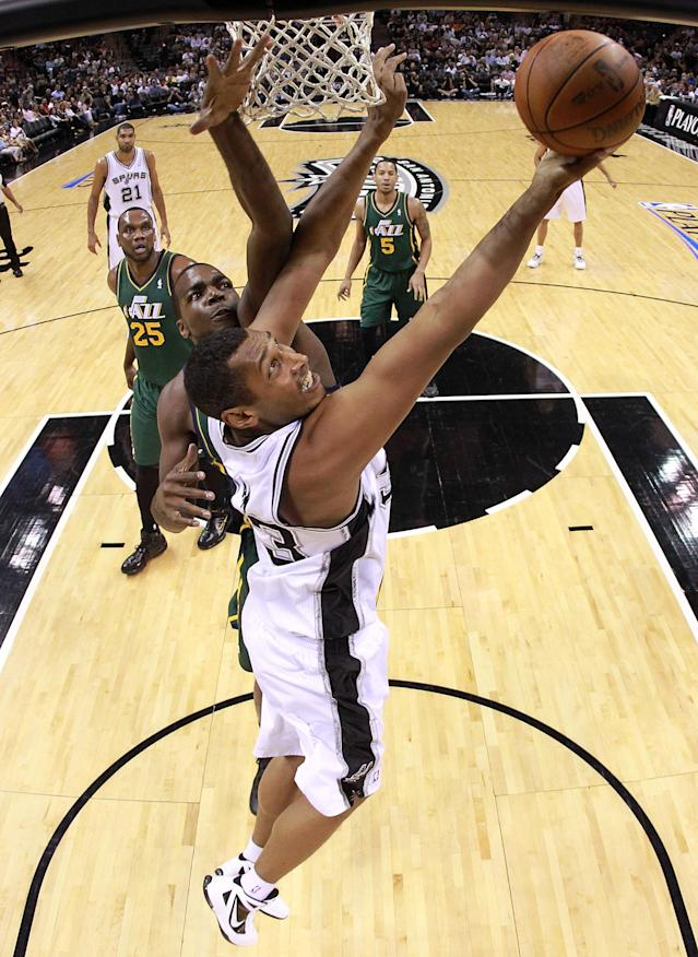 SAN ANTONIO, TX - MAY 02: Boris Diaw #33 of the San Antonio Spurs takes a shot against Paul Millsap #24 of the Utah Jazz in Game Two of the Western Conference Quarterfinals of the 2012 NBA Playoffs at AT&T Center on May 2, 2012 in San Antonio, Texas. NOTE TO USER: User expressly acknowledges and agrees that, by downloading and or using this photograph, User is consenting to the terms and conditions of the Getty Images License Agreement. (Photo by Ronald Martinez/Getty Images)