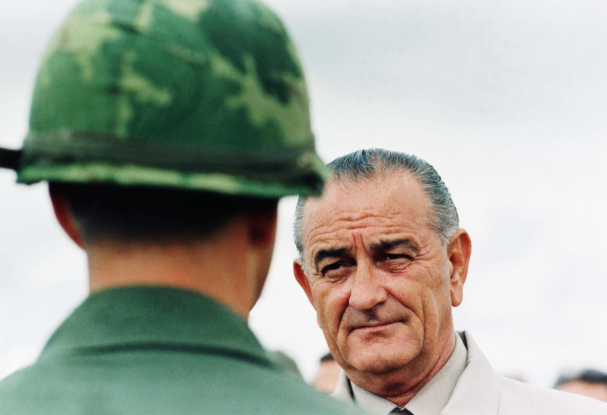 President Lyndon B. Johnson meets soldiers during a surprise visit to an American base in Cam Rahn Bay in South Vietnam. October 1966. (Photo by © CORBIS/Corbis via Getty Images)