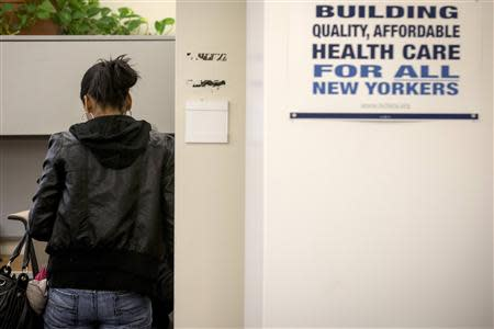 A woman waits to work with a volunteer navigator to find a health care plan at the Community Service Society in New York