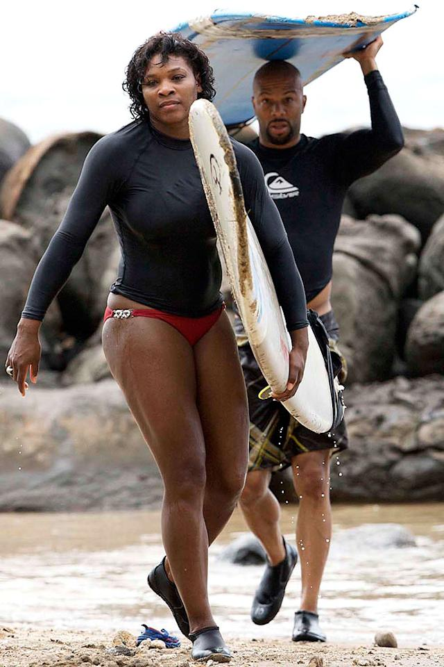 "Serena Williams and her main squeeze Common prepare to catch some waves while on vacation in Hawaii. starsurf/<a href=""http://www.splashnewsonline.com"" target=""new"">Splash News</a> - October 13, 2008"