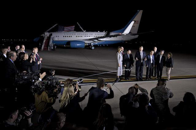<p>President Donald Trump, fifth right, speaks to members of the media as First Lady Melania Trump, left, Vice President Mike Pence, second left, Mike Pompeo, Secretary of State, third right, stand with American citizens, released from detention in North Korea, Kim Sang-dok, also known as Tony Kim, sixth right, Kim Dong-chul, fourth right, and Kim Hak-song, second right, at Joint Base Andrews, Maryland, U.S., on Thursday, May 10, 2018. (Photo: Andrew Harrer/Bloomberg via Getty Images) </p>