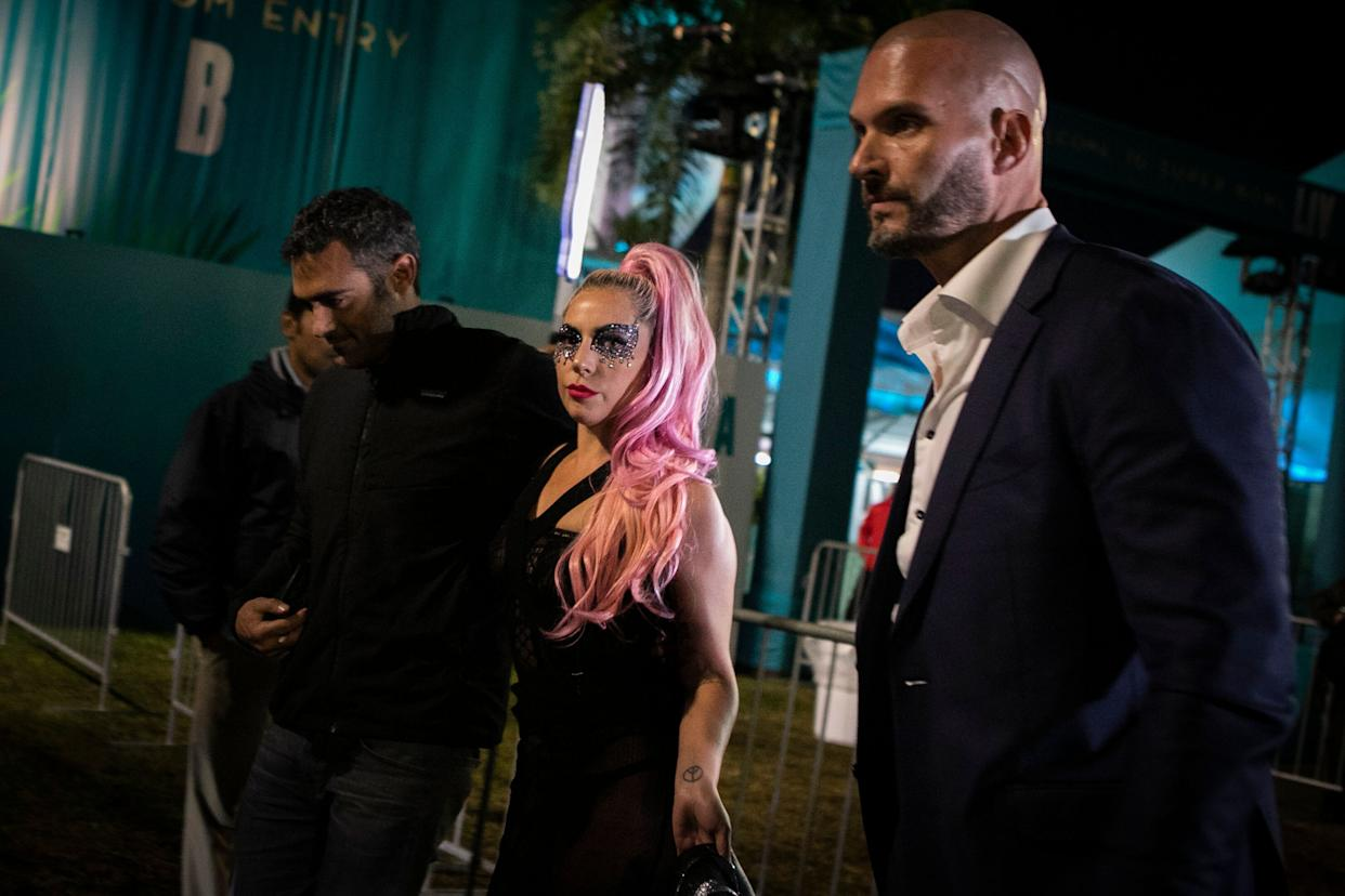 Lady Gaga and Michael Polanksy, left, leave the Super Bowl in Miami Gardens, Florida.