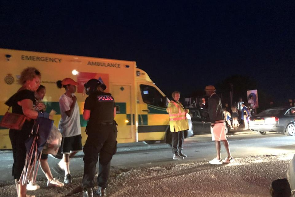Ambulance workers and police officers in the evening (Susan Pilcher)
