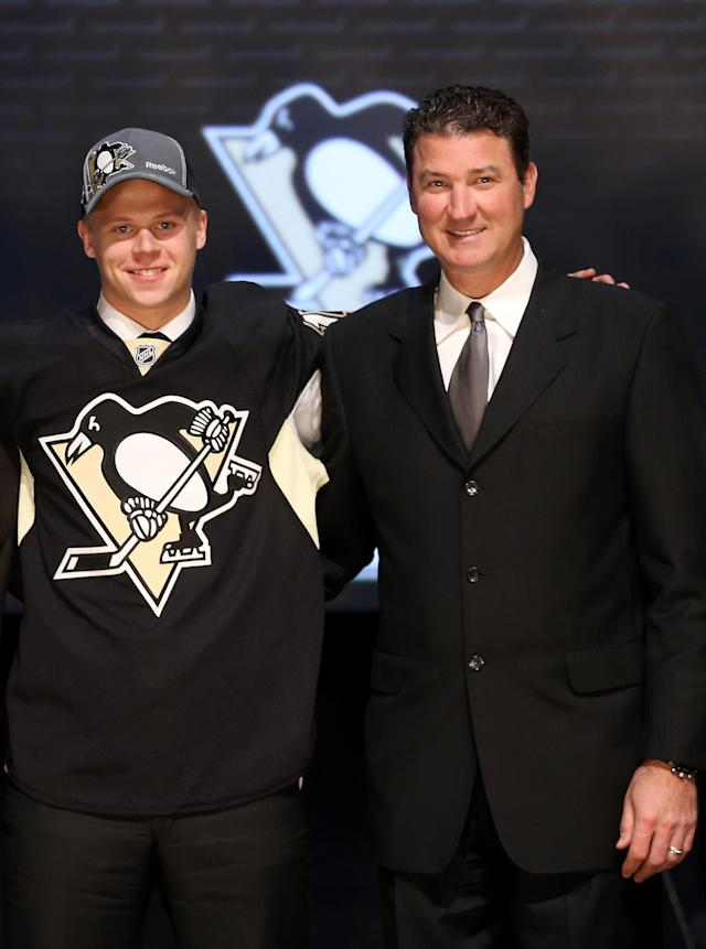 PITTSBURGH, PA - JUNE 22: Olli Maatta (L), 22nd overall pick by the Pittsburgh Penguins, poses with Penguins co-owner Mario Lemieux on stage during Round One of the 2012 NHL Entry Draft at Consol Energy Center on June 22, 2012 in Pittsburgh, Pennsylvania. (Photo by Bruce Bennett/Getty Images)