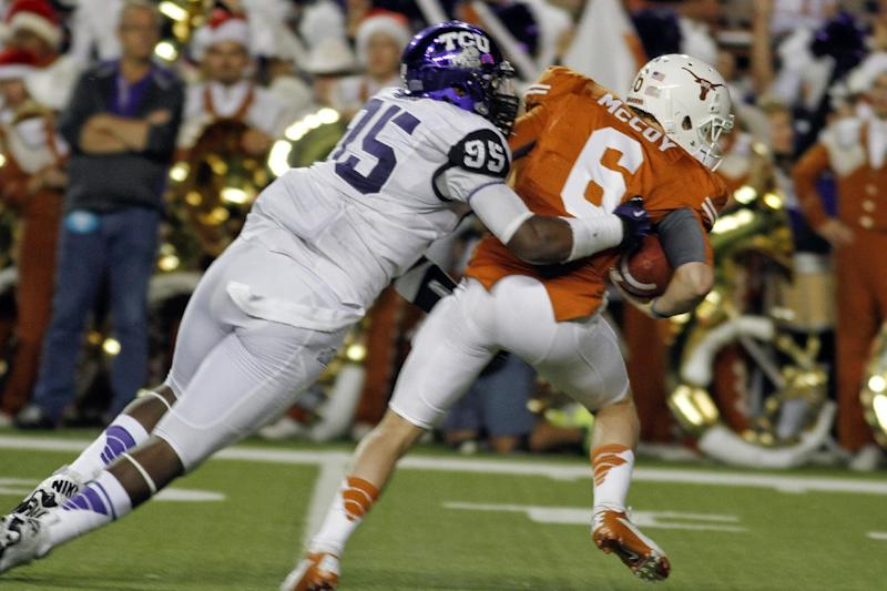 Texas quarterback Case McCoy (6) is sacked by TCU defensive end Devonte Fields (95) late in the first half of an NCAA college football game on Saturday, Nov. 22, 2012, in Austin, Texas. (AP Photo/Jack Plunkett)