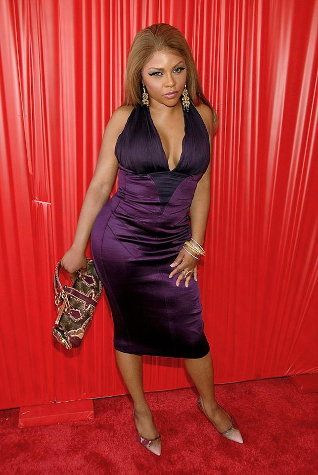 "In one of the night's biggest surprises, Lil' Kim kept the majority of her body covered in a pleasant purple dress. Frank Micelotta/<a href=""http://www.gettyimages.com/"" target=""new"">GettyImages.com</a> - June 24, 2008"
