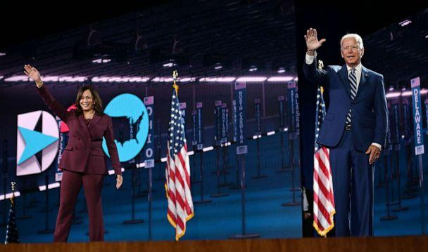PHOTO: Sen. Kamala Harris and former Vice President Joe Biden wave from the stage at the end of the third day of the Democratic National Convention, in Wilmington, Del., Aug. 19, 2020. (Olivier Douliery/AFP via Getty Images)