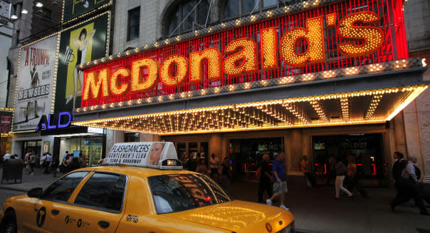 In this July 11, 2013 photo, a McDonald's marquis is illuminated in New York's Times Square. (AP Photo/Mark Lennihan)