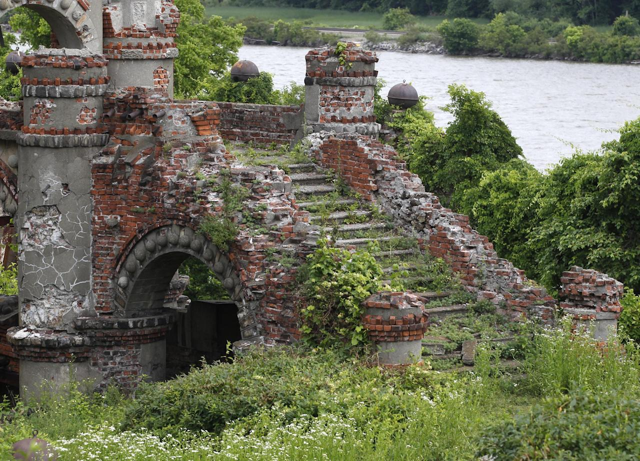 A staircase of the Bannerman's Island Arsenal is seen on Pollepel Island, N.Y., on Tuesday, June 5, 2012. Though it looks like it was built to withstand battering rams, it was actually a surplus military goods warehouse made to resemble a Scottish castle. Businessman Francis Bannerman VI had it built early in the 20th century as a place to store helmets, haversacks, mess kits and munitions he could not store in his thriving shop in Manhattan. (AP Photo/Mike Groll)