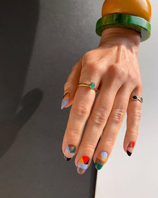 """<p>Can't pick a <a href=""""https://www.cosmopolitan.com/style-beauty/beauty/news/g5202/glitter-nail-polish-colors/"""" target=""""_blank"""">polish color</a>? No prob. Have your technician recreate this insanely pretty gel manicure design, which features the<strong> coolest combination of blue, red, green, black, and more.</strong> You get a little bit of everything with this one.</p><p><a href=""""https://www.instagram.com/p/B9DaM5oHrCK/"""">See the original post on Instagram</a></p>"""