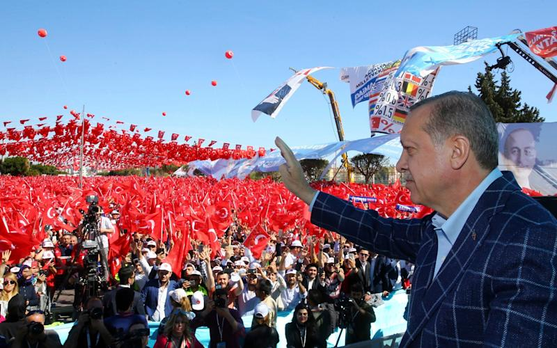 Turkey's President Recep Tayyip Erdogan addresses his supporters in Antalya - Credit: Pool Presidential Press Service/AP