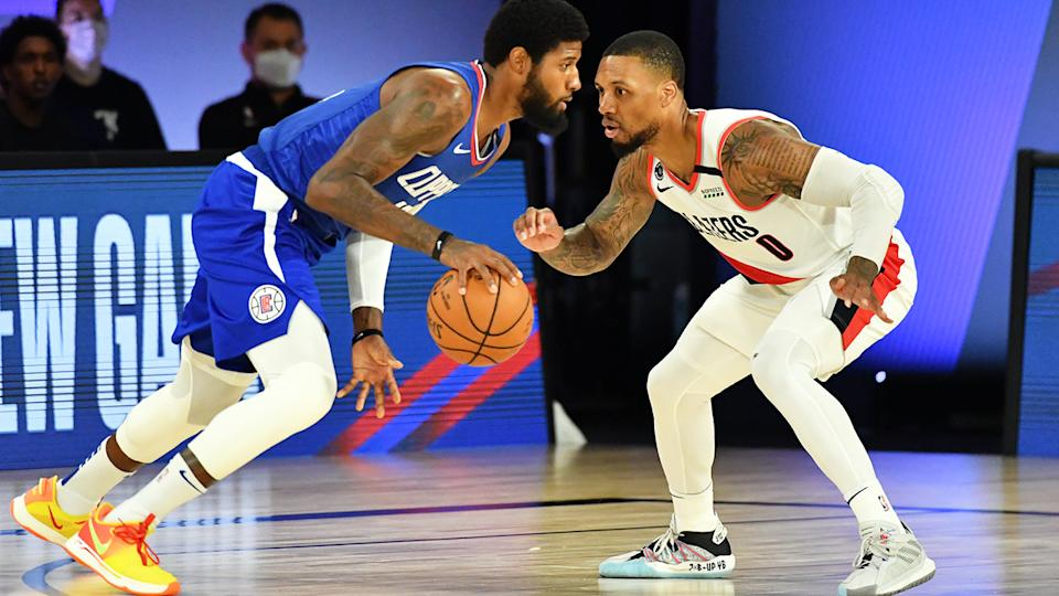 LA Clippers star Paul George is pictured playing against Portland rival Damian Lillard.