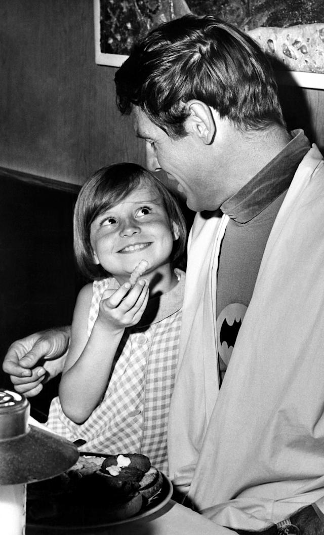 <p>Wide-eyed Dina Burke, 8, whose father donated $1,000 to charity so she could lunch with TV's Batman, offers The Bat – Adam West – a French fry during lunch at a Hollywood restaurant in Los Angeles, June 28, 1966. Her father, actor Paul Burke, donated the money at a Hollywood charity auction. (Photo/Ellis R. Bosworth/AP) </p>