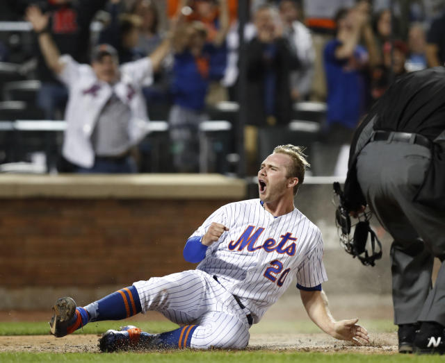 New York Mets' Pete Alonso (20) reacts as he scores on Wilson Ramos' two-run single during the seventh inning of a baseball game against the St. Louis Cardinals, Friday, June 14, 2019, in New York. (AP Photo/Kathy Willens)