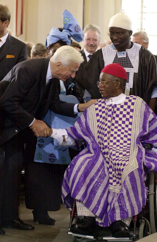 "FILE - In this Oct. 13, 2002 file photo, Richard von Weizaecker, left, former German President, congratulates Nigerian author Chinua Achebe, after Achebe was awarded the prestigious Peace Prize of the German publishing industry at the Paul's Church in Frankfurt Main, Germany. Achebe, who wrote the classic, ""Things Fall Apart,"" has died. He was 82. Achebe's publisher confirmed his death Friday, March 22, 2013. (AP Photo/dpa, Frank May, File)"