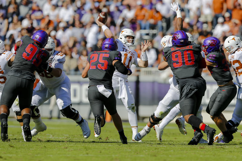 FORT WORTH, TX - OCTOBER 26: Texas Longhorns quarterback Sam Ehlinger (11) looks downfield for an open receiver as TCU Horned Frogs defensive end Wyatt Harris (25) rushes in during the game between the TCU Horned Frogs and the Texas Longhorns on October 26, 2019 at Amon G. Carter Stadium in Fort Worth, Texas. (Photo by Matthew Pearce/Icon Sportswire via Getty Images)
