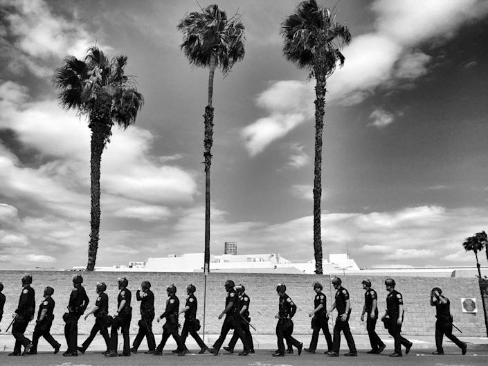 <p>Riot police move in to quell protests outside a Donald Trump rally on May 25 in Anaheim, Calif. (Photo: Holly Bailey/Yahoo News) </p>